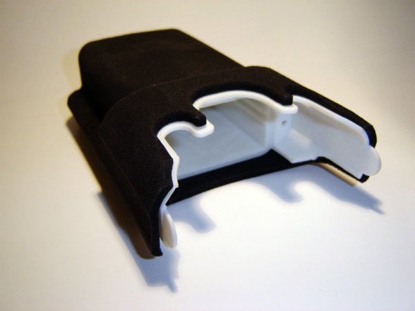 3D Printed White nylon part with separate black rubber-like cover